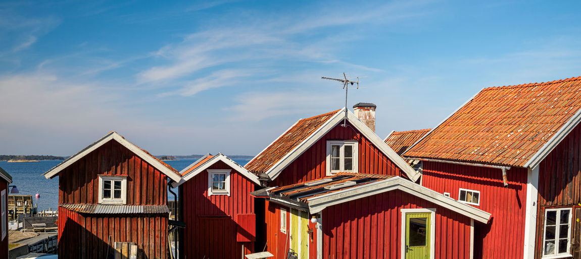 Multi colored buildings against sky