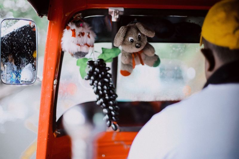Close-up of man driving rickshaw