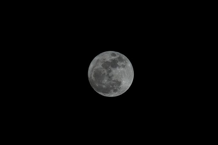 Low angle view of moon against black sky