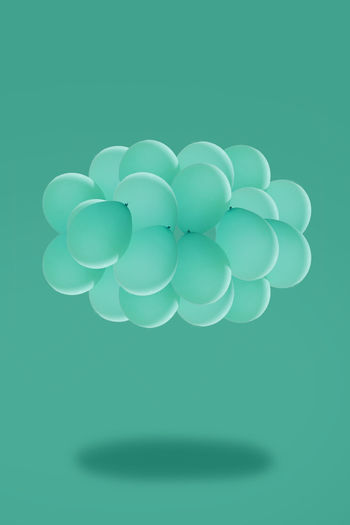Close-up of blue balloons against black background