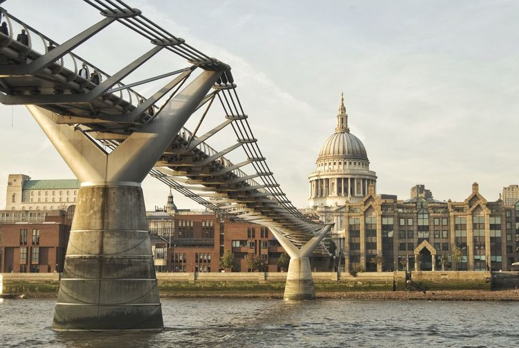 Millennium Bridge Over Thames River Against St Paul Cathedral