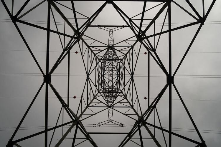 Electricity Pylon Electricity  Built Structure Low Angle View Fuel And Power Generation Sky No People Architecture Metal Pattern Power Supply Technology Connection Power Line  Cable Complexity Directly Below Nature Tall - High Outdoors Ceiling Girder