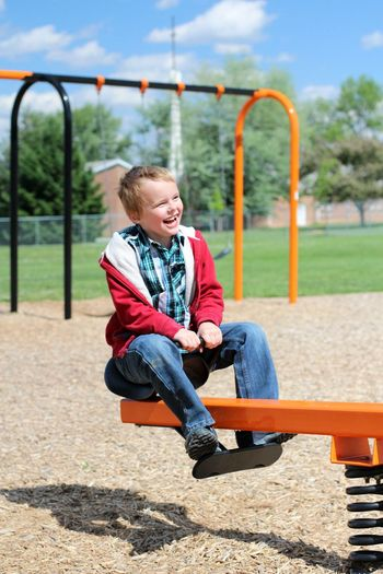 Boy playing at playground