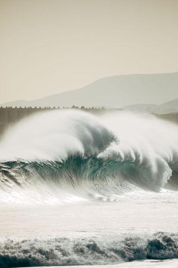 Waves on sea against sky