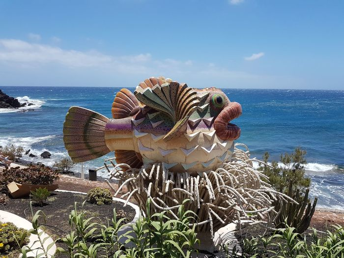 Art Structure Beauty In Nature Blue Fish Sculpture Horizon Over Water No People Scenics - Nature Sea Tranquil Scene Water