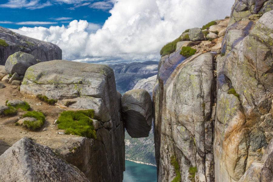 The infamous Kjeragbolten boulder located on the mountain Kjerag, Norway. Cloud - Sky Geology Kjeragbolten Norway Rock - Object Rock Formation Rocky Sky