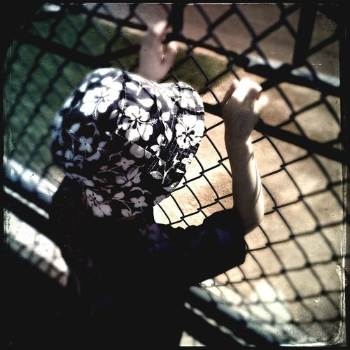 Child With A Hat Watching Baseball