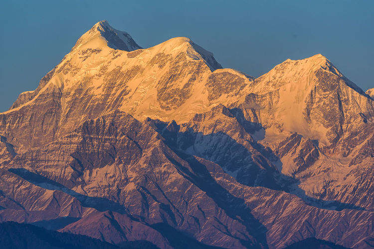 Majestic Trishul Peaks Mountain Beauty In Nature Scenics - Nature Mountain Range Tranquil Scene Sky Physical Geography Tranquility Nature Environment Non-urban Scene Rock Idyllic Sunlight Landscape No People Geology Day Remote Formation Snowcapped Mountain Mountain Peak Arid Climate Climate Trishul