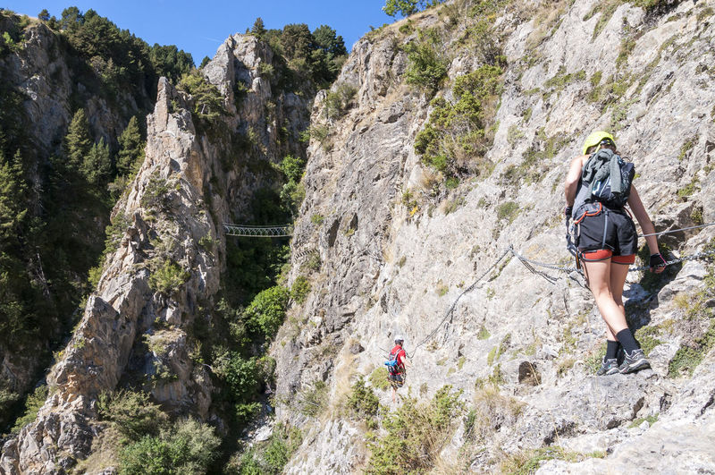 Via ferrata canal de Grau at Canillo in Andorra Activity Adrenaline Adventure Bridge Cable Challenge Cliff Climbing Dangerous Exciting Extreme Sports Helmet Mountain Outdoors RISK Rock - Object Rock Climbing Rocks Rope Safe Secured Sport Via Ferrata Women