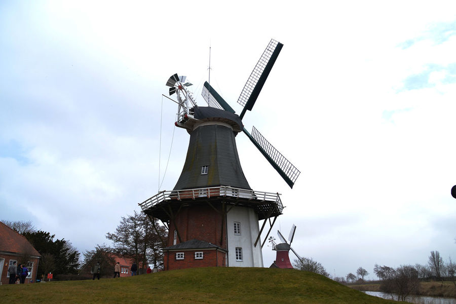 Alternative Energy Cloud Cloudy Day Environmental Conservation Field Grass Grassy Gray Day. Green Color Greetings Low Angle View No People Ostfriesland Outdoors Renewable Energy Rural Scene Sky Tall Tall - High Wind Power Windmill