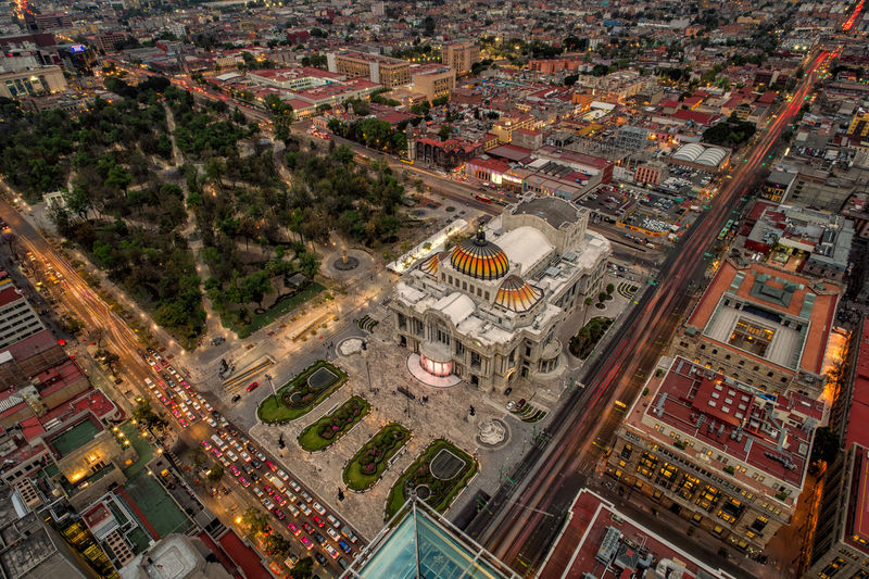 Long exposure high angle view over Mexico City including the palacio de bellas artes during rush hour Cars Commuting Mexico Mexico City Mobility in Mega Cities Rush Hour Traffic Aerial View Architecture Building Exterior Buildings Built Structure Cdmx City Cityscape High Angle View Illuminated Long Exposure Motion Movement No People Outdoors Travel Destinations