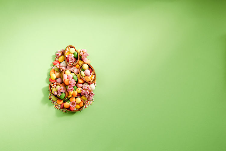 Directly above shot of multi colored candies against green background