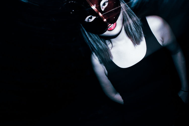 Portrait of woman in eye mask at nightclub