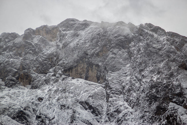 Mountain Sky Cold Temperature Winter Rock Nature Snow No People Scenics - Nature Beauty In Nature Tranquility Rock - Object Day Solid Tranquil Scene Mountain Range Rock Formation Non-urban Scene Environment Outdoors Formation Mountain Peak Snowcapped Mountain