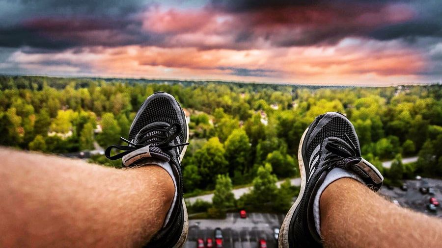Just having fun 😜 . And yes my legs are hanging above 80 meters 👌📸 Shoe Personal Perspective No Photoshop Human Body Part Low Section Cloud - Sky One Person Men Adventure Lifestyles Sky Nature Landscape Sitting Young Adult Day People Outdoors One Man Only Leisure Activity