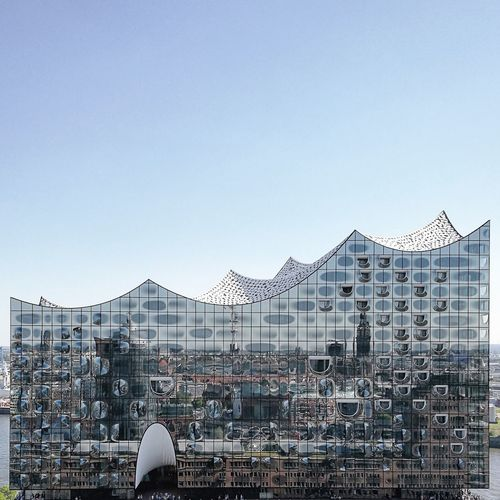 reflection. Architecture Blue Building Exterior Built Structure City Cityscape Clear Sky Day Elbphilharmonie Elphie Hamburg Hamburgahoi HuaweiP9 Modern No People Ontheroof Outdoors Reflections Skrwt Sky Straightfacade Travel Destinations Welovehh