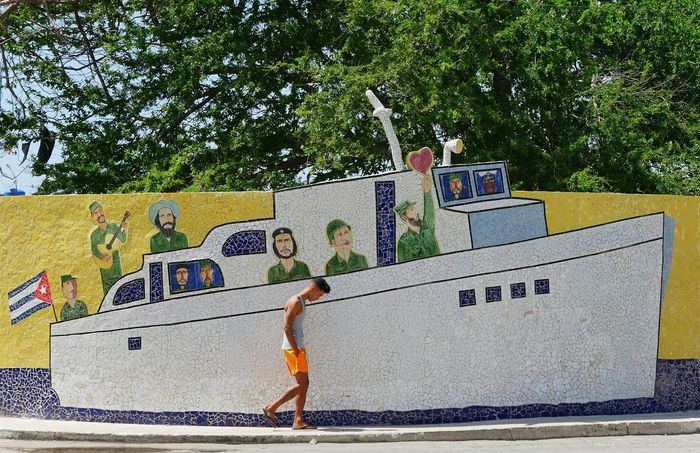 A man walks in front of a mosaic tile mural in Havana, Cuba. Check This Out Cuban Cuba Colors Lumixlounge LUMIX GX8 Mural Mural Art Mosaic Tiles Fidel Castro Art Imitating Life Public Art Travel Travel Photography Streetphotography Street Photography Your Design Story Feel The Journey