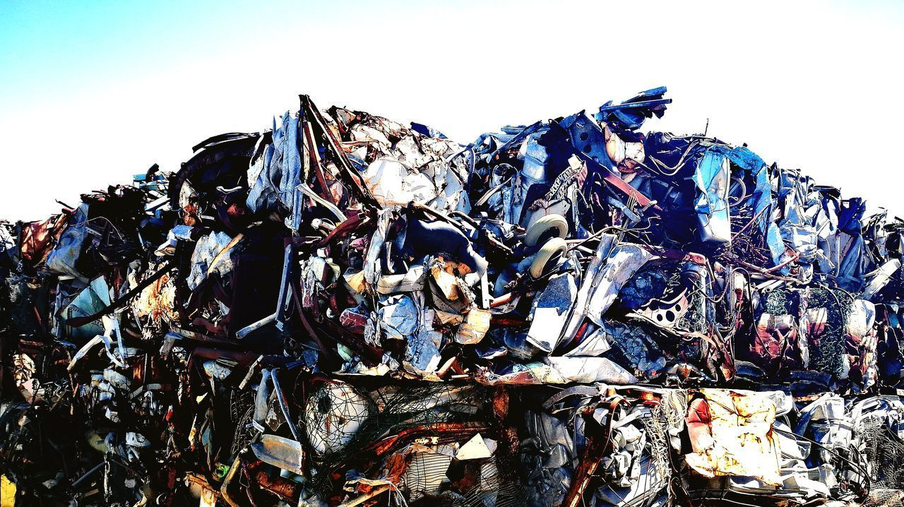 garbage, garbage dump, heap, abundance, waste management, large group of objects, stack, pollution, junkyard, environment, scrap metal, environmental issues, clear sky, outdoors, no people, day, recycling center, white background, sky