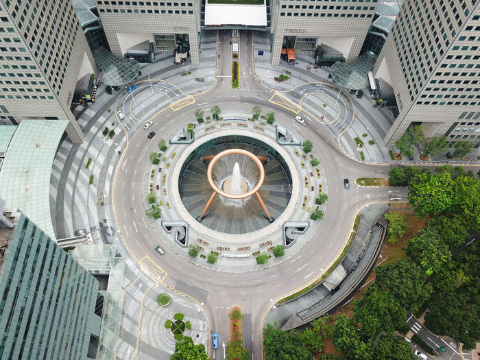 Aerial view of fountain amidst modern buildings in city