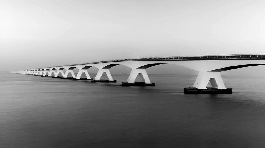Zeeland Bridge Over Bay Against Clear Sky