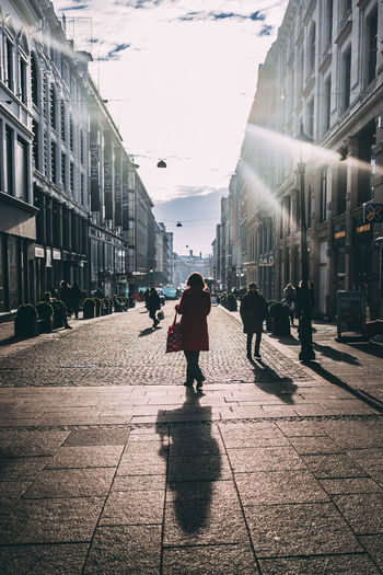 Oslo Adult Architecture Backlit Building Exterior Built Structure City Day Full Length Lifestyles Men Outdoors People Real People Rear View Sky Street Streetphotography Sunlight The Way Forward Two People Walking Women