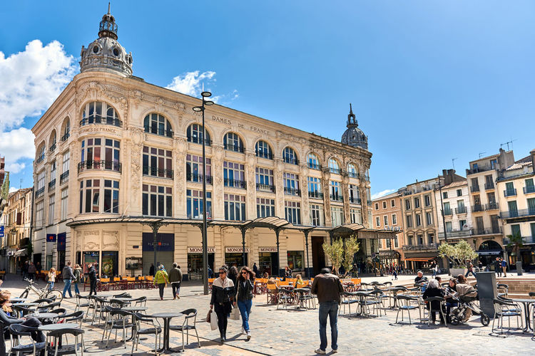 Narbonne, France - April 8, 2016: People walking in a city main square in Narbonne, Languedoc-Roussillon. France Architecture City Commercial Editorial  Food And Drink France Languedoc-Roussillon Languedoc-Roussillon Midi-Pyrénées Main Square Narbonne Old Town Outdoors Outdoors Restaurant Pedestrian Walkway People Sidewalk Sidewalk Cafe Spring Stores Street Sunny Day Touristic Place Travel Destinations Urban Landscape Western Europe