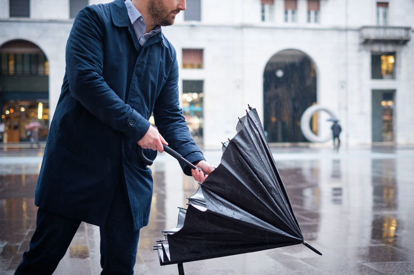 Adult Adults Only Architecture Building Exterior Business Businessman City Day Focus On Foreground Lifestyles Men One Person Outdoors People Rainy Real People Umbrella Well-dressed