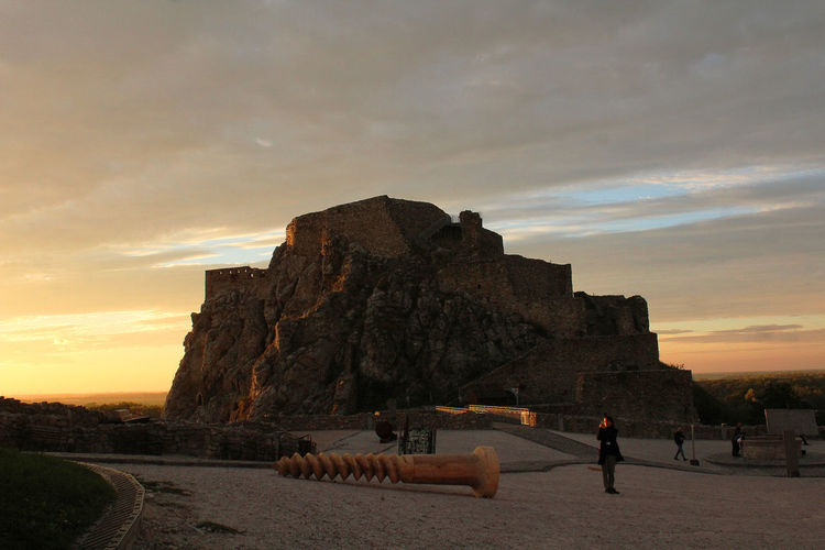 Adult Architecture Beauty In Nature Cloud - Sky Devin Castle Evening Evening Sky Golden Hour Group Of People History Land Leisure Activity Lifestyles Men Nature Outdoors People Real People Rock Rock - Object Scenics - Nature Sky Sunset The Past Travel Destinations