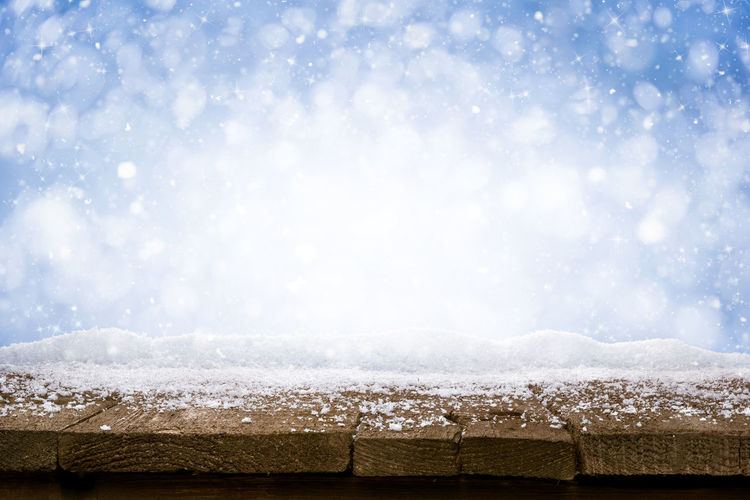 Scenic view of snow against sky during winter