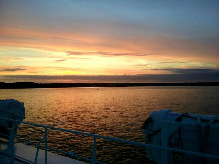 Water Sunset Nautical Vessel Scenics Mode Of Transport Transportation Part Of Boat Tranquility Tranquil Scene Cloud - Sky Tourism Travel Vacations Beauty In Nature Sea Travel Destinations Non-urban Scene Nature Sky Outdoors Curtain Cloud Mountain Beauty
