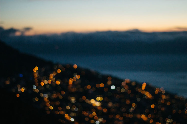 Signal Hill Lights. Sitting above the city, looking down on Seapoint on a warm Sunday evening. Mid March, 2019. Defocused Illuminated No People Night Sunset Sky Glowing Lens Flare Light - Natural Phenomenon Nature Lighting Equipment Orange Color Outdoors Jonnynichayes Cape Town South Africa Bokeh My Best Photo Minimalism Copy Space Beauty In Nature Technology Technology Everywhere Light City Life Cityscape Cloud - Sky Twilight Explore Adventure Focus