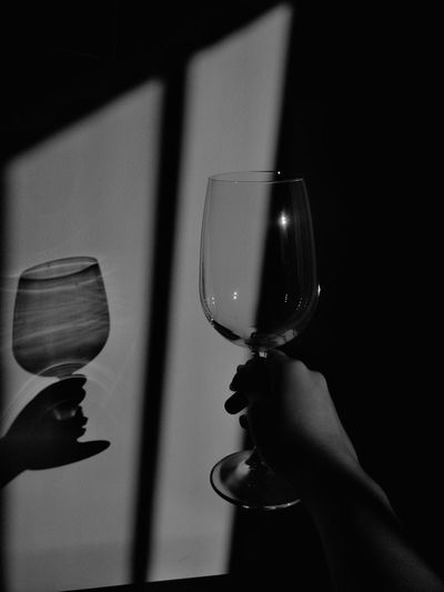 Midsection of person holding wineglass