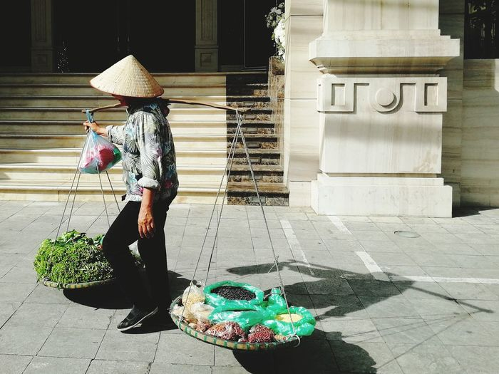 PhonePhotography P9 Huawei Outdoors Shadow One Person Traditional Traditional Culture Traditional Clothing Walking Full Length Hat Architecture Building Exterior Asian Style Conical Hat Straw Hat Sun Hat Vietnamese Culture Vietnam The Street Photographer - 2018 EyeEm Awards