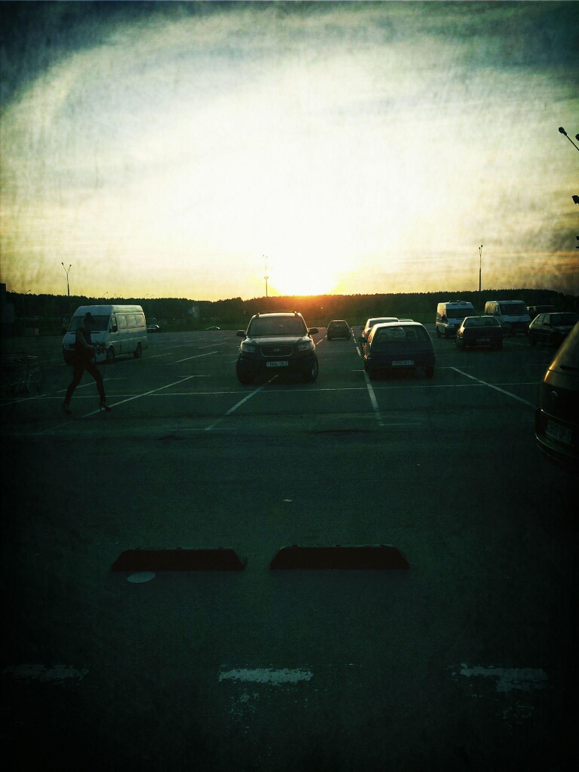 transportation, car, land vehicle, mode of transport, sunset, sky, road, street, silhouette, on the move, sunlight, cloud - sky, travel, sun, road marking, outdoors, cloud, sunbeam
