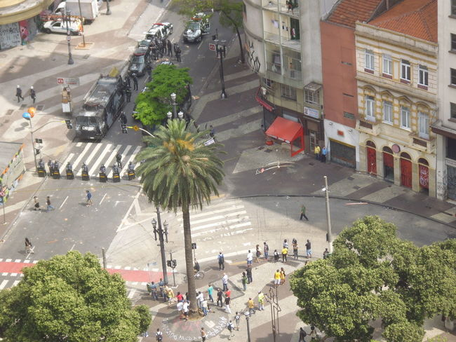 Court Ordered Eviction by Military Police of the Homeless Squatters who had invaded the Hotel Aquarius in downtown São Paulo (This photo part of a series; for all documentary images and film captured regarding the events that occurred in downtown São Paulo on September 16, 2014 contact Photographer via EyeEm.) Avenida São João Burning Eyes EyeEmNewHere Largo Do Paissandu NewToEyeEm September 16, 2014 Squatter Eviction By Military Police Squatter Eviction From Hotel Aquarius Susan A. Case Sabir Unretouched Photography Anger And Revolt Downtown São Paulo First Time Published High Angle View Inner City Urban Violence Panic In The City Real-life Events Rebellion Of The Homeless Riot In Downtown São Paulo Rubber Bullets Smoke Bombs Socio-economic Problems Street Photography Tear Gas Thisweekoneyeem
