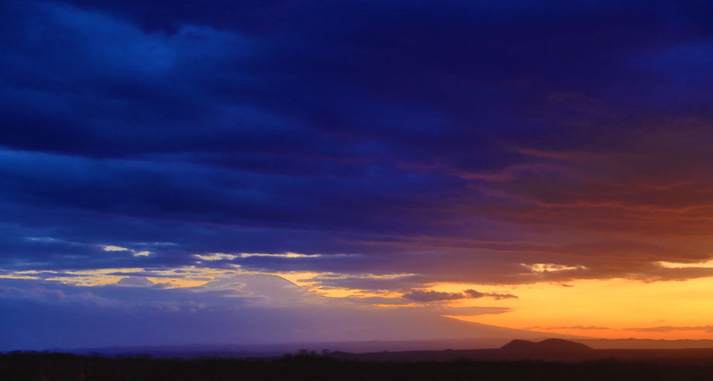Kilimanjaro in the sunset, view from Amboseli NP in Kenya Adventure Africa Amboseli National Park Astronomy Cloud - Sky Dramatic Sky Endlessness Kilimanjaro National Parks Kenya Silhouette Storm Cloud Summertime Sunset Tranquil Scene Tranquility Wideness