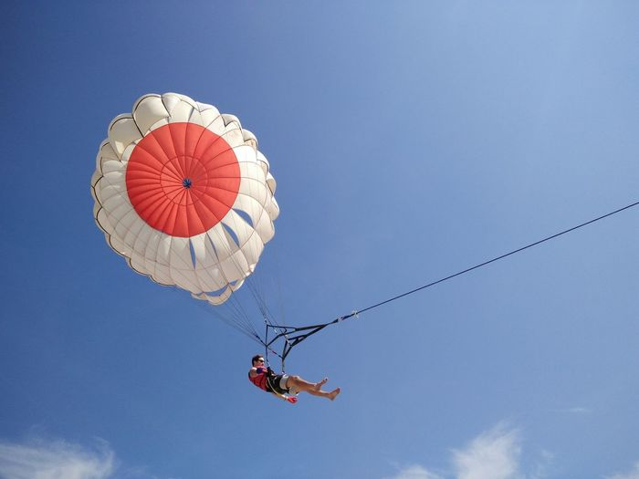 Adventure Arts Culture And Entertainment Blue Day Enjoyment Freedom Fun Leisure Activity Lifestyles Low Angle View Mid-air Motion Multi Colored Outdoors Sky Parasailing Watersports Nusadua Tanjungbenoa Bali, Indonesia