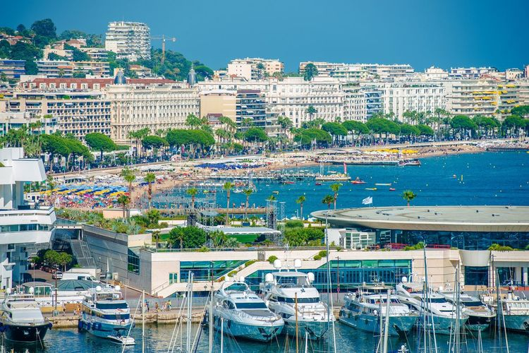 Cannes Waterfront France. Cannes Famous Beach and Marina. Cannes France Architecture Building Building Exterior Built Structure City Cityscape Day French Riviera Harbor High Angle View Marina Mode Of Transportation Moored Nature Nautical Vessel No People Office Building Exterior Outdoors Port Residential District Sailboat Sea Sky Transportation Water Yacht