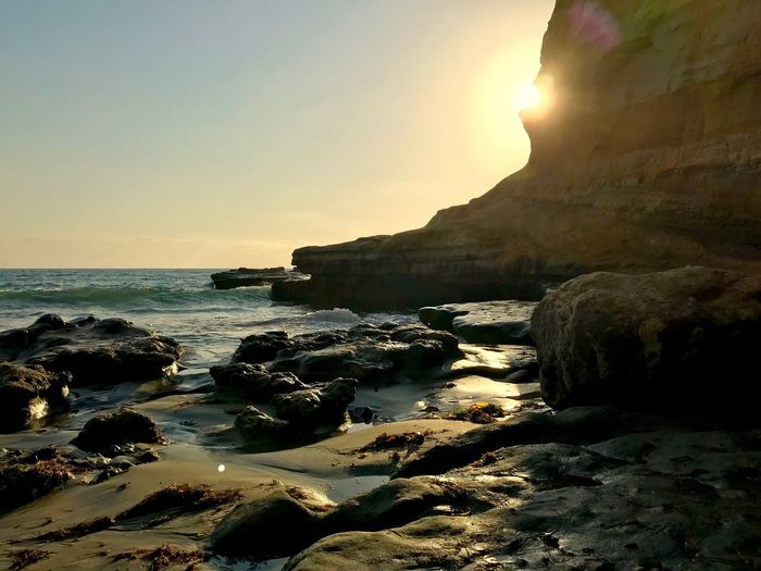 Sea Rock - Object Nature Beauty In Nature Rock Formation Sunset Scenics Tranquility Tranquil Scene Beach Sun Water Horizon Over Water Sky No People Sunlight Outdoors Travel Destinations Sand Wave IPhone7Plus IPhoneography