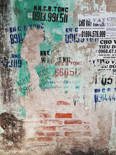 Vietnam Vietnamese ASIA Asian  Asian Culture Backgrounds Full Frame Textured  Text Graffiti Close-up Architecture Written Worn Out Peeling Off Deterioration Weathered Abandoned Obsolete Run-down Wall Discarded