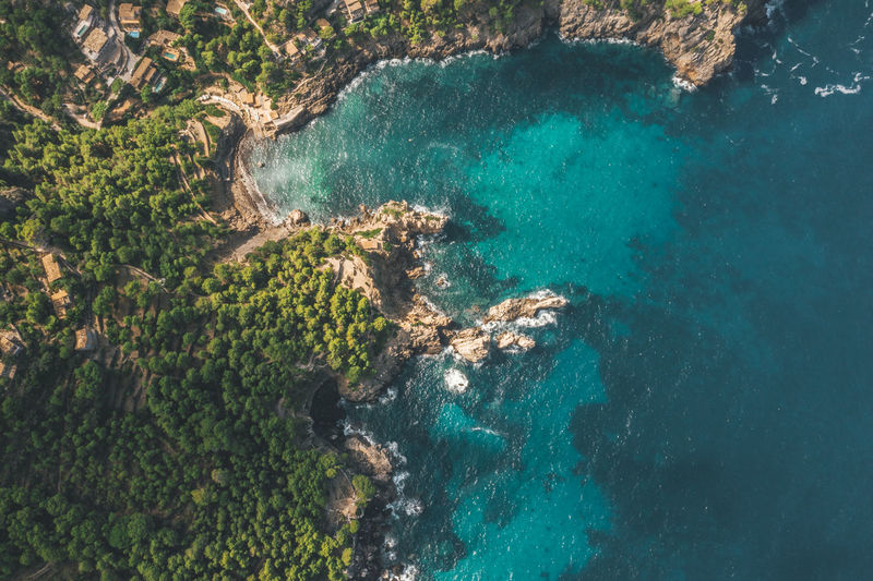 Aerial view of tropical coastline with rich colours and turquise water in spain