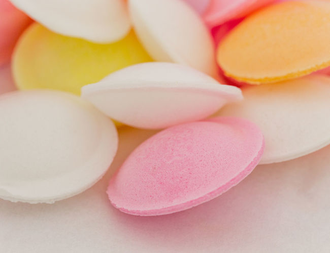 Close up images of coloured sherbet filled 'flying saucers' sweets Colourful Orange Pink Pink Sweets Pink Candy Rice Paper Candy Close-up Colorful Coloured Candy Coloured Sweets Day Flying Saucers Food Food And Drink Indoors  Macro No People Sherbet Sherbet Fountain Sweets White Yellow
