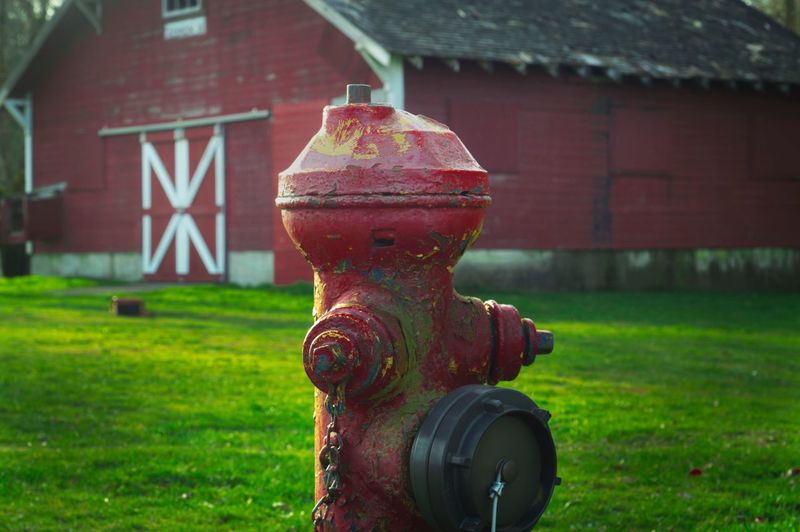 Fire Hydrant By Barn On Field