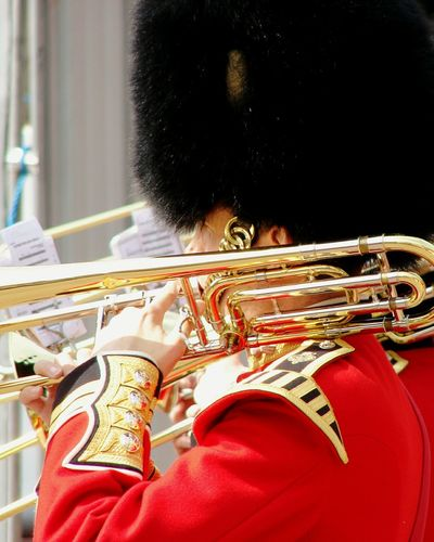 Side View Of British Royal Guard With Brass Instrument On Shoulder