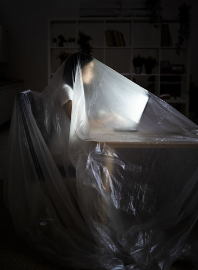 Close-up of woman wrapped in plastic bag