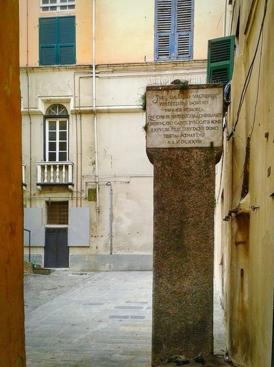 """""""Nei Caroggi di Genova - Colonna infame """". Text more or less reads: To the shameful memory of Julius Caesar Vachero wicked man that conspired against the (genoese) Republic he had the head cut-off the properties taken the sons exiled the house demolished so he paid his guilt anno domini 1628 /the column is relatively difficult to be spotted as the descendents got the permission to hide it by a fountain that I will post next / Gogna Pillory Historic Historical Monuments Centro Storico Di Genova Historical Center Downtown Narrow Alleys Narrow Places (actually the small plaza is there just because his house was demolished LOL but it is true) Genova ♥ ScriptMobile Photography S3mini HDR shooting mode Snapseed and EyeEm"""