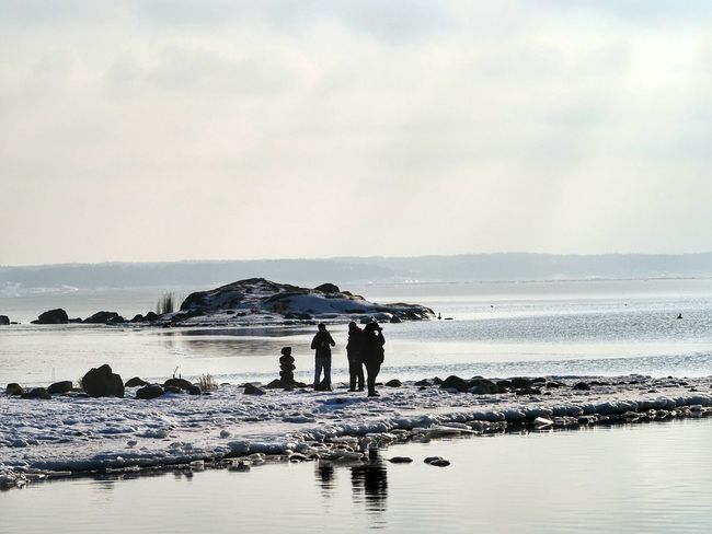 Winter Nature Outside Looking At The Sea On The Beach Silhouettes Appointment Enjoying The View Spare Time Winter Walks On The Beach people and places Peoplephotography Water Working Sea Full Length Men Togetherness Beach Occupation Fisherman