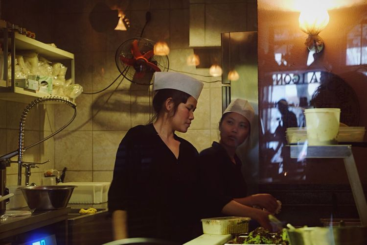 A glimpse into the kitchen Berlin Restaurant Cooking Kitchen People Working People