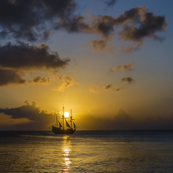 Sunset in the Grand Cayman Sunset_collection Boat Cayman Islands Horizon Over Water Island Nature Ocean Outdoors Reflection Sailboat Sailing Sea Sea And Sky Ship Sky Skyporn Sunrise Sunset Sunsetporn Sunsets Water Water_collection Waterfront California Dreamin