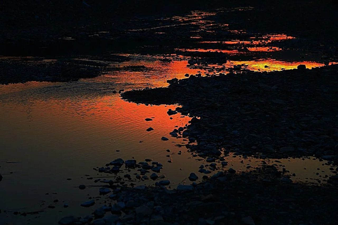 reflection, water, outdoors, nature, no people, sunset, silhouette, beauty in nature, day, close-up